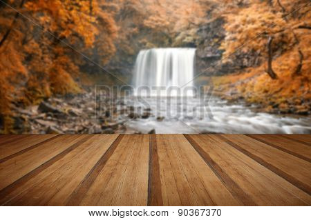 Beautiful Woodland Stream And Waterfall In Autumn Fall With Wooden Planks Floor