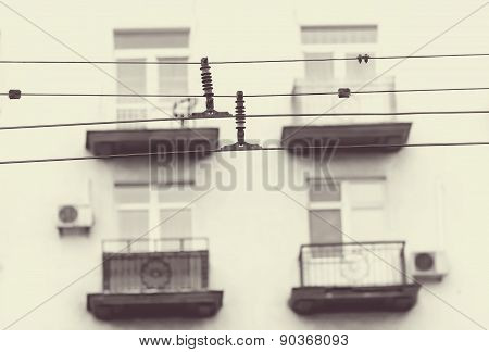 Wire Trolley On The Background Of The Balconies Of The Houses In Sepia