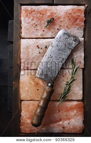 Butcher Knife On Pink Salt And Spices