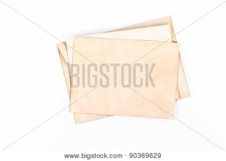 isolated vintage envelope with yellow paper page. View from above.