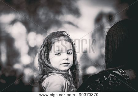 Little Pretty Girl Walking On The City Street With Mother