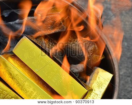 gold paper burning
