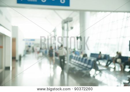 Blurred photo of an airport terminal.