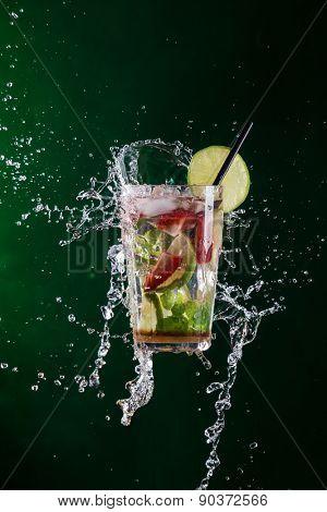 fresh mojito drink with liquid splash, freeze motion.