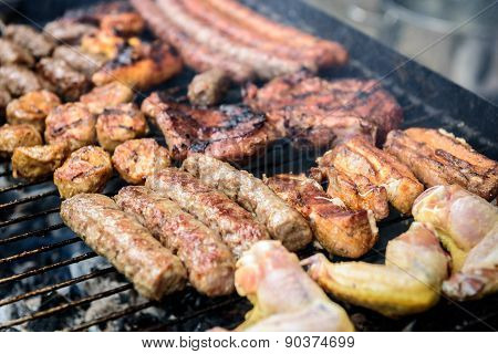 Meat Skewer On Barbecue Grill With Coal.