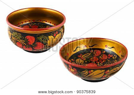 Wooden old Russian Khokhloma tableware with painting.