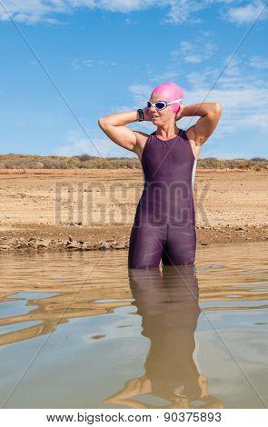 Female Triathlete Entering The Water