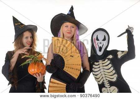 Three women witches posing in scary outfits