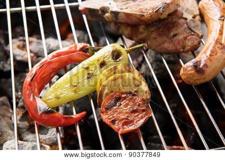 Vegetables Grilled And Sausages And Prok Chop On The Grill