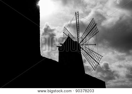 Windmill Silhouette And Clouds