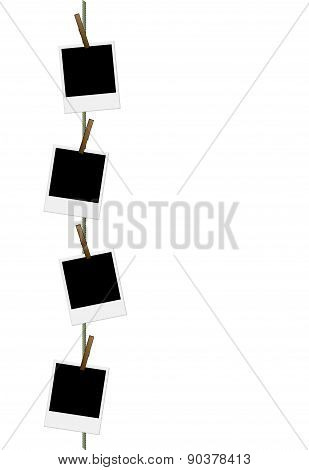 Blank vertical photo frames on a clothesline
