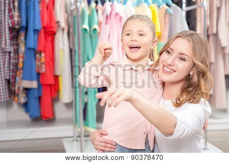Young mother with small daughter in a fashion store