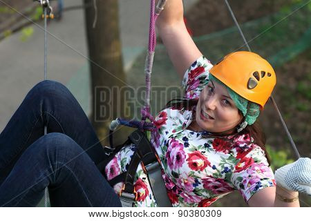 Woman Climber Hanging On A Rope