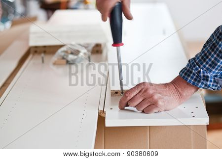 Man Assembling Flat Pack Furniture