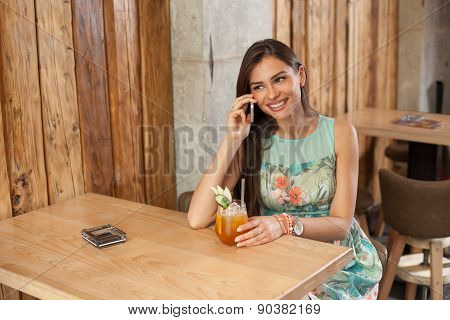 Young Woman In A Cafe Using Mobile Phone
