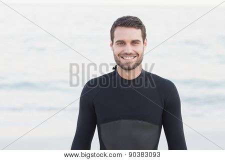 Man in wetsuit on a sunny day at the beach