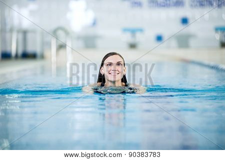 Portrait of a young woman in sport swimming pool