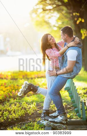 Young couple on roller skates in the park
