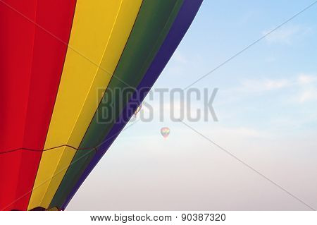 Hot Air Balloons Floating In The Morning Sky