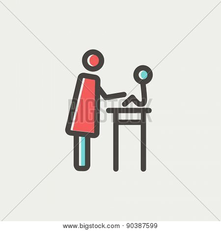 Mother taking care of her baby sitting on high chair icon thin line for web and mobile, modern minimalistic flat design. Vector icon with dark grey outline and offset colour on light grey background.