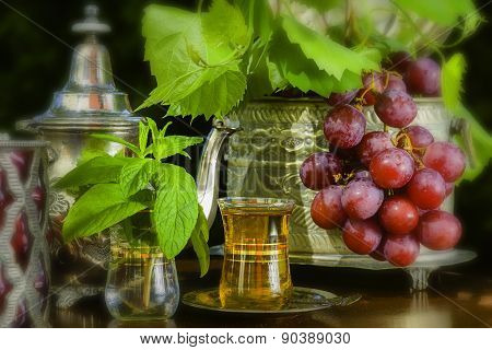 Mint Tea And Red Grapes On Arabian Table