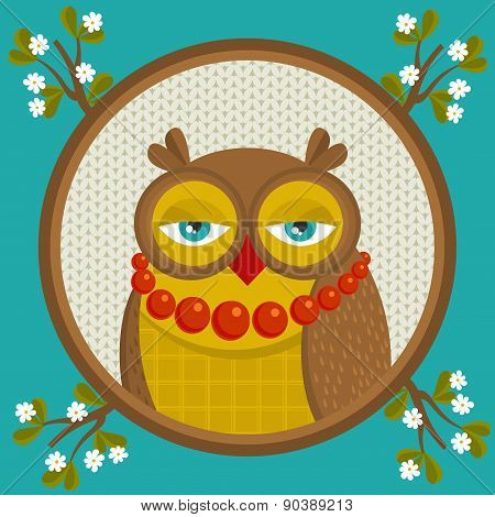Portrait of fashionable owl in the frame with branch in flowers.
