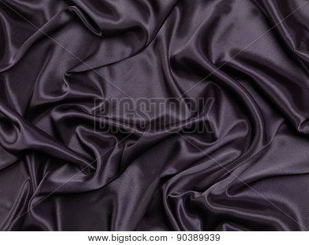 Black shiny silky fabric abstract background texture