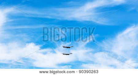 Two Strategic Bomber Airplanes In White Clouds