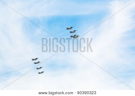 Flight Military Pursuit Aircrafts In White Clouds