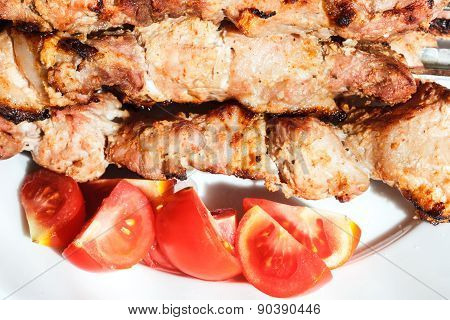 Pieces Of Pieces Of Red Tomato And Shish Kebabs