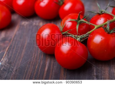 Red Cherry Tomatoes On The Wooden Table