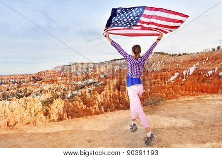 Woman holding US flag, Bryce Canyon National Park