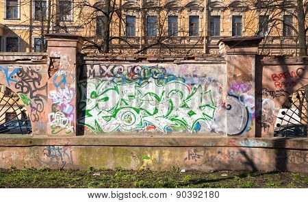 Abandoned Urban Fence With Colorful Graffiti