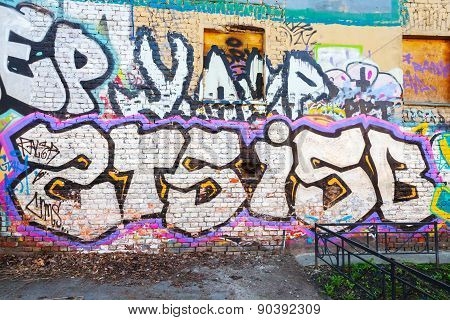 Abstract Graffiti Text Patterns On Old Brick Wall