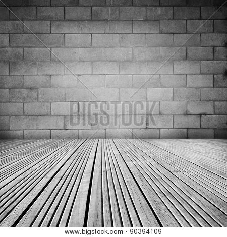 Wooden floorboards and block wall