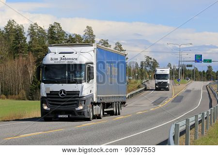 Two Mercedes-Benz Actros Trucks On The Road