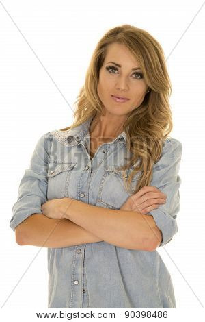 Woman In A Blue Shirt Arms Folded Looking