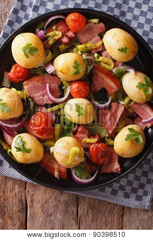 Tasty New Potatoes With Onion, Tomato And Bacon Top View