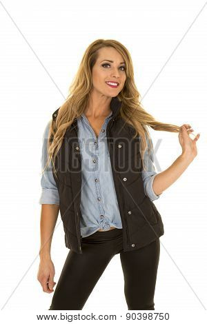Woman With Black Vest Stand Play With Hair