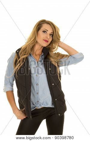 Woman With Black Vest Stand Looking Hand In Hair