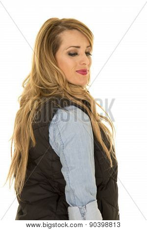 Woman With Black Vest Stand Side Look Down