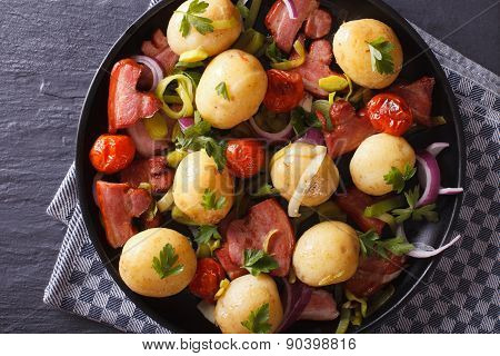 New Potatoes With Bacon Close-up. Horizontal Top View