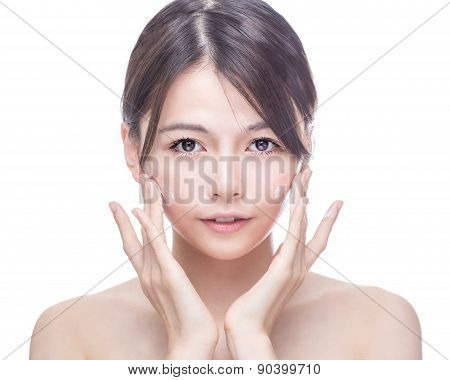 Asian Beauty Applying Cream To Face