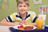 image of school lunch  - Portrait of smiling boy with school lunch - JPG