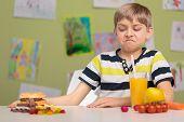 stock photo of school lunch  - Schoolchild choosing healthy food for school lunch - JPG