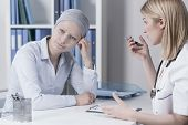 stock photo of leukemia  - Young businesswoman with cancer in doctor - JPG