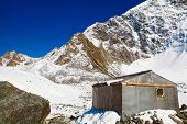 image of snow capped mountains  - House and Snow capped mountains - JPG