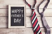 picture of tied  - Rectangle picture frame with Happy fathers day sign and two ties laid on wooden floor backround - JPG