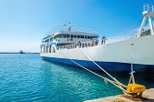 picture of loading dock  - Docked Greek Ferry in painted typical blue - JPG