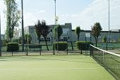 picture of hollow point  - green tennis court in the town of la spezia - JPG
